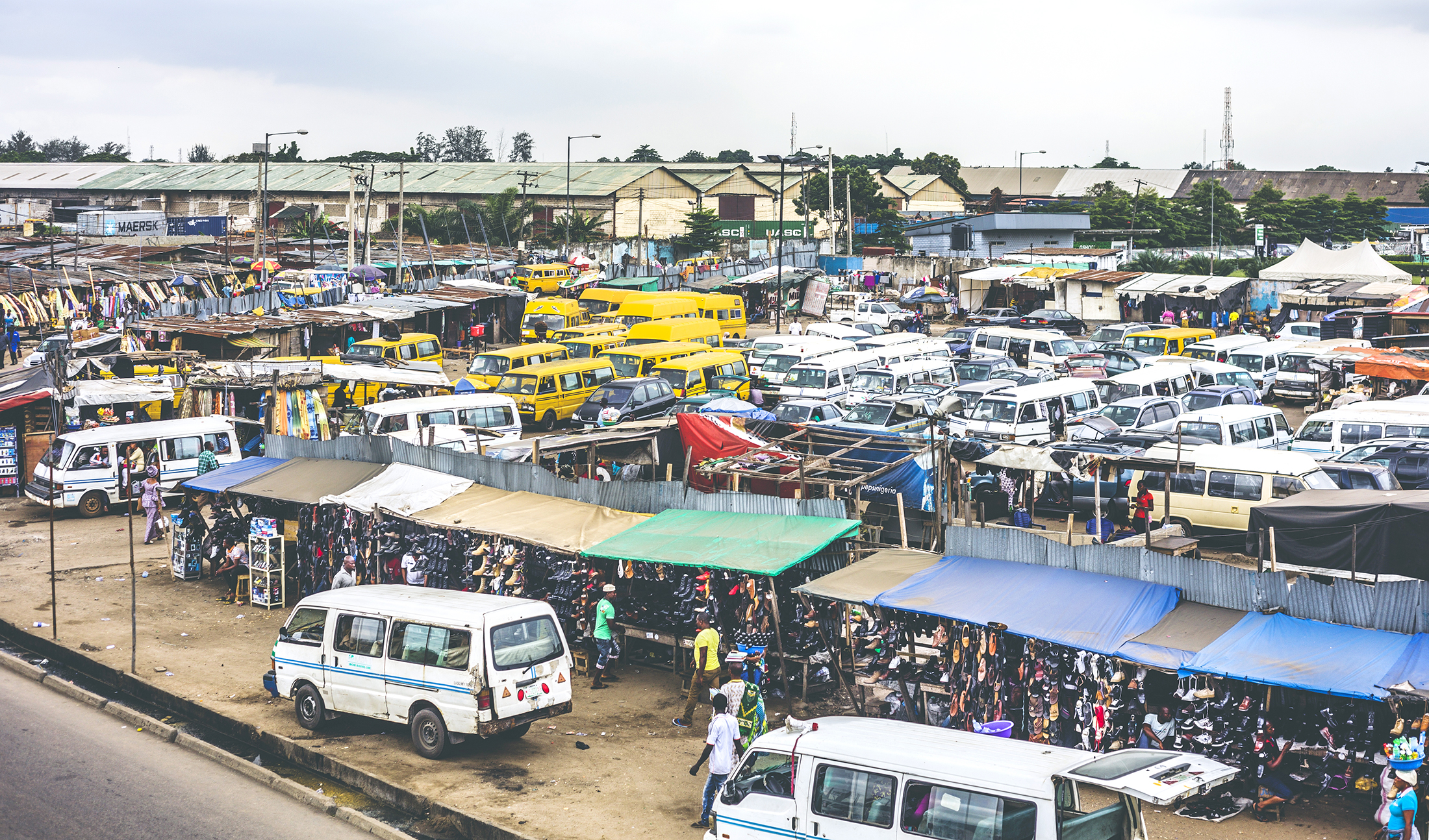 A crowded bus station in Lagos, Nigeria. The country's 170 million-strong population has put a strain on its housing market